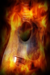 Acoustic guitar with fire flame screen.