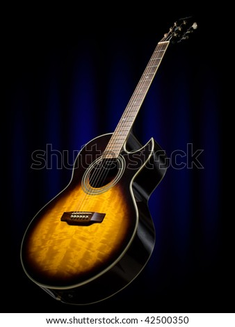 acoustic guitar with the blue stage curtain in the background