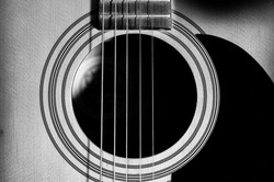 Acoustic Guitar with very shallow depth of field, focus on strings. Black & White