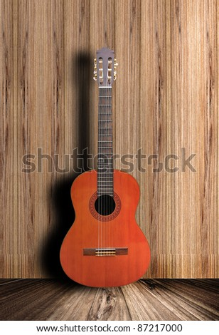 Acoustic guitar with wooden background - stock photo