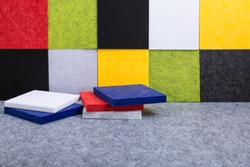Acoustic panels in red, blue, green, yellow, gray, white, black colors