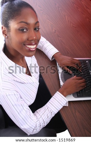 Acrican American Woman With Computer Sitting At Desk