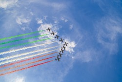 Acrobatic air performance of Frecce tricolori (tricolour arrows) in the sky