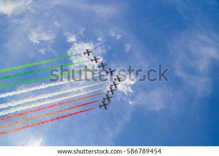 Acrobatic air performance of Frecce tricolori (tricolour arrows) in the sky