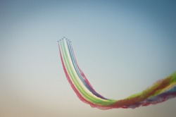 Acrobatic airplane formations with colorful smoke for the 47th United Arab Emirates National Day air show in Abu Dhabi, UAE on December 2nd, 2017