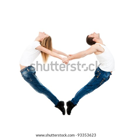 Acrobatic couple forming a valentine's heart shape with their bodies isolated over white background concept of valentine day symbol of freedom peace and love