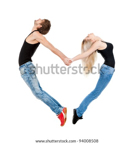 Acrobatic couple forming a valentine's heart shape with their bodies, isolated over white background, concept of valentine day, symbol of freedom, peace and love - stock photo