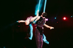 Acrobats performs a difficult trick in the circus.