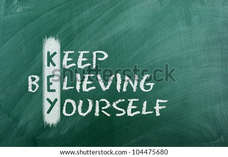 Acronym of KEY. Believe in yourself written in chalk on a blackboard .