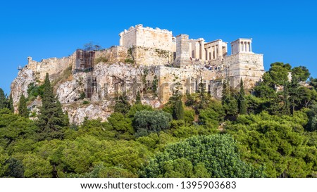 Acropolis of Athens, scenic view of Propylaea, Greece. Famous old Acropolis is a top landmark of Athens. Scenery of Ancient Greek ruins in the Athens center. Panorama of remains of antique Athens.