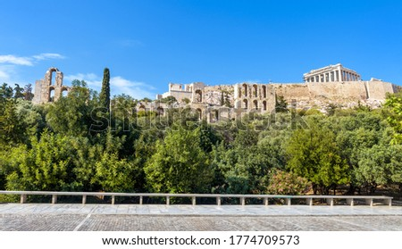 Acropolis with old Parthenon temple, Athens, Greece. This place is top landmark of Athens. Panoramic view of famous Acropolis hill and Ancient Greek ruins in Athens center. Urban landscape of Athens.