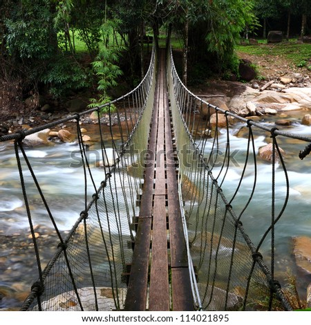 Across the suspension bridge waterfall,Thailand