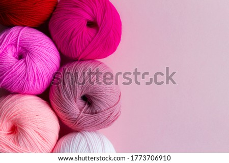 Acrylic balls of yarn on a pink background. Nuance color combination. Skeins are located vertically on the left. Photo stock ©