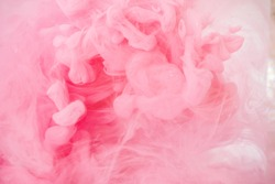Acrylic colors and ink in water. Abstract background, Cloud of silky ink in water on white isolated background, Ink drop in water, pink ink splash