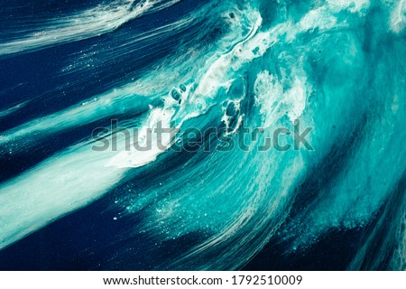 Photo of  Acrylic ink water. Sea storm. Cyan blue ocean wave splash with white foam effect. Marble texture creative design. Nature art background. Mineral rock abstract pattern with fleck sparkles.