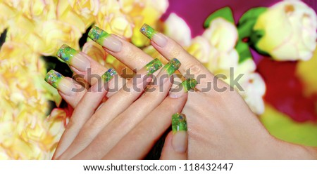 Acrylic nails with bits of green acrylic and Golden sand.