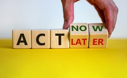 Act now, not later symbol. Male hand turns wooden cubes and changes words 'act later' to 'act now'. Business and act now or later concept. Beautiful yellow table, white background, copy space.