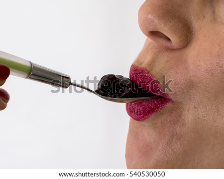 Act Of Eating Lips Parted On A Spoonful Jam Synonym For Taste