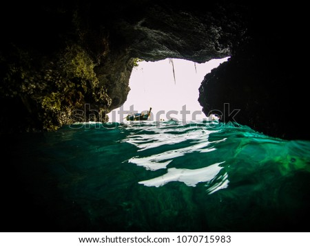 Action cam picture of the entrance of the Emerald cave (mokarot cave) in Ko Muk, Ko Lanta, Thailand.