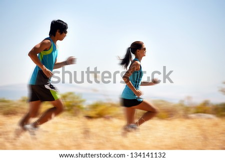 action motion blur of running athlete in field with fitness