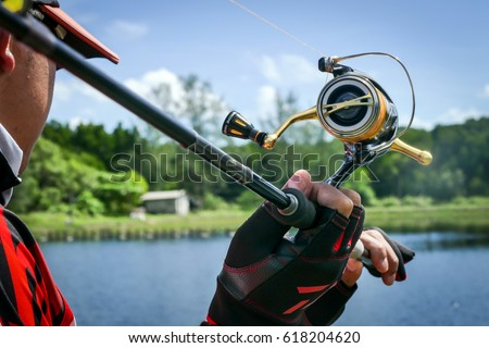 action of lure angler casting with spinning reel in fishing tournament #618204620