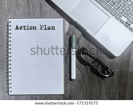 Action Plan, Typed Words On a handbook with note book, marker pen and notebook. Vintage and classic background mood with noise.