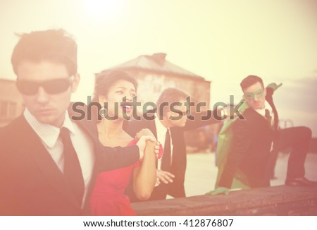 Action Scene of Business People : A Hero in a Corporate Attire Trying to Save the Woman