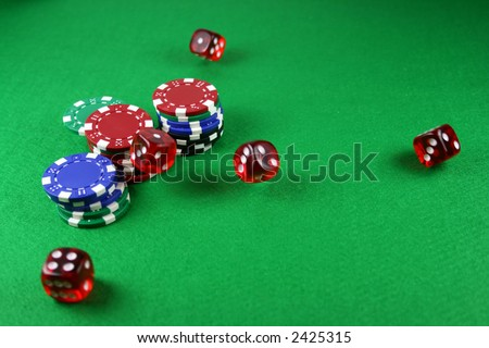 Action shot of 5 dice thrown onto a table - fast shutter showing dice in the air