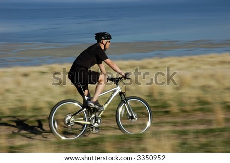 Action shot of mountain biker in motion