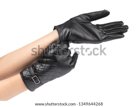 81fa4c2a0 Action symbol of hand with black winter leather gloves Isolated on white  background #1349644268