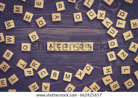 Action word on wood table for business concept.