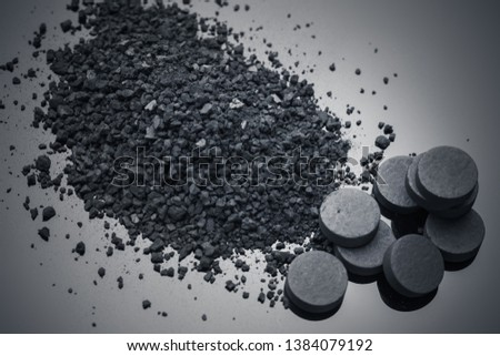 Activated carbon granulated and tablets detoxification concept.