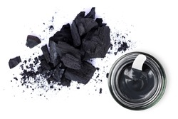 Activated charcoal powder and Clay or charcoal mud cream in jar isolated on white background. Top view. Flat lay. Beauty spa, skin care, natural face mask concept.