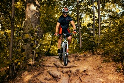 Active bicyclist riding at the forest.Healthy lifestyle and outdoors adventure.
