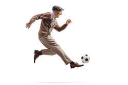 Active elderly man playing football isolated on white background