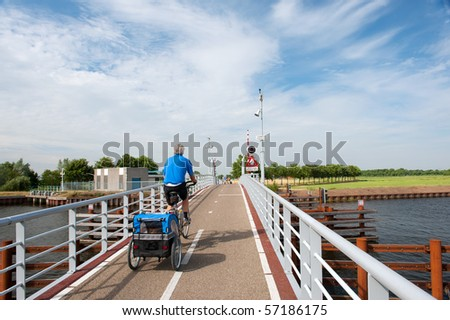 active elderly man with his doggy ride on the bike - stock photo