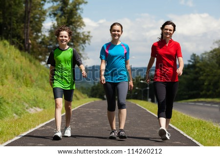 Active family - mother and kids walking , running outdoor