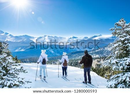 Active family skiing on winter vacation. Rocky Mountain National Park. Close to Estes Park, Colorado, USA Stock photo ©
