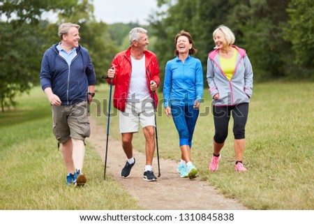 Active group of seniors together while hiking in nature