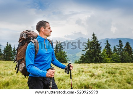 Active healthy man hiking in Alpine mountains #520926598