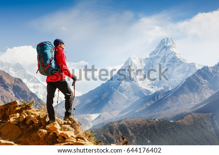 Active hiker enjoying the view. Himalayas. Nepal