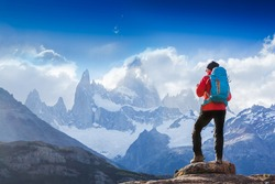 Active hiker hiking, enjoying the view, looking at Patagonia mountain landscape. Fitz Roy, Argentina. Mountaineering sport lifestyle concept