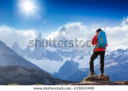 Active hiker hiking, enjoying the view, looking at Patagonia mountain landscape. Fitz Roy, Argentina. Mountaineering sport lifestyle concept #618063488