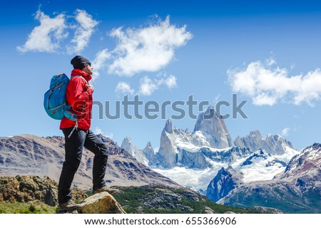 Active hiker hiking, enjoying the view, looking at Patagonia mountain landscape. Fitz Roy, Argentina. Mountaineering sport lifestyle concept #655366906