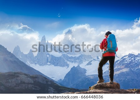 Active hiker hiking, enjoying the view, looking at Patagonia mountain landscape. Fitz Roy, Argentina. Mountaineering sport lifestyle concept #666448036