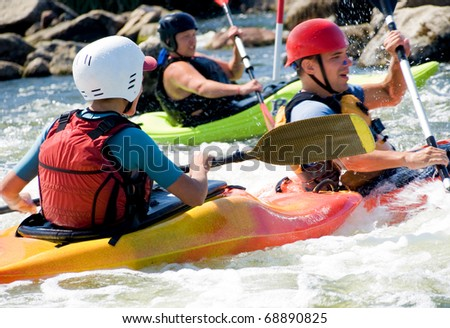 active kayakers on the water