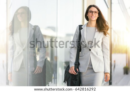 Active lifestyle of mixed ethnicity career business woman walking to work place office