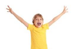 Active little boy in t-shirt on white background