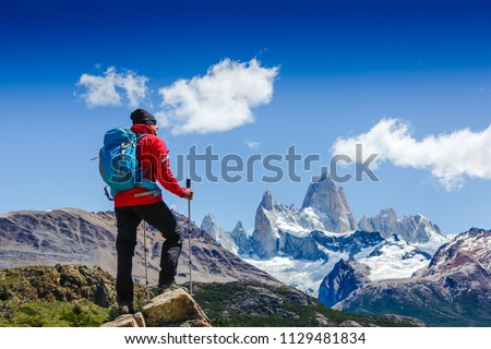 Active man hiking in the mountains. Patagonia, Mount Fitz Roy. Mountaineering sport lifestyle concept #1129481834