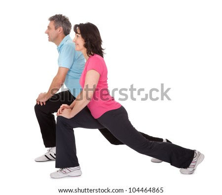 Active mature couple doing fitness. Isolated on white